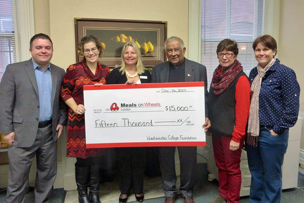 Westminster College Foundation presents a cheque to Meals on Wheels.